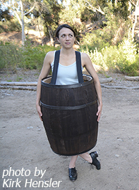 dancer dressed in a barrel